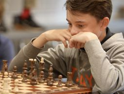 Middle School students check in at chess tournament