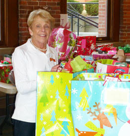 Marilyn Legg organizing gifts for toy drive