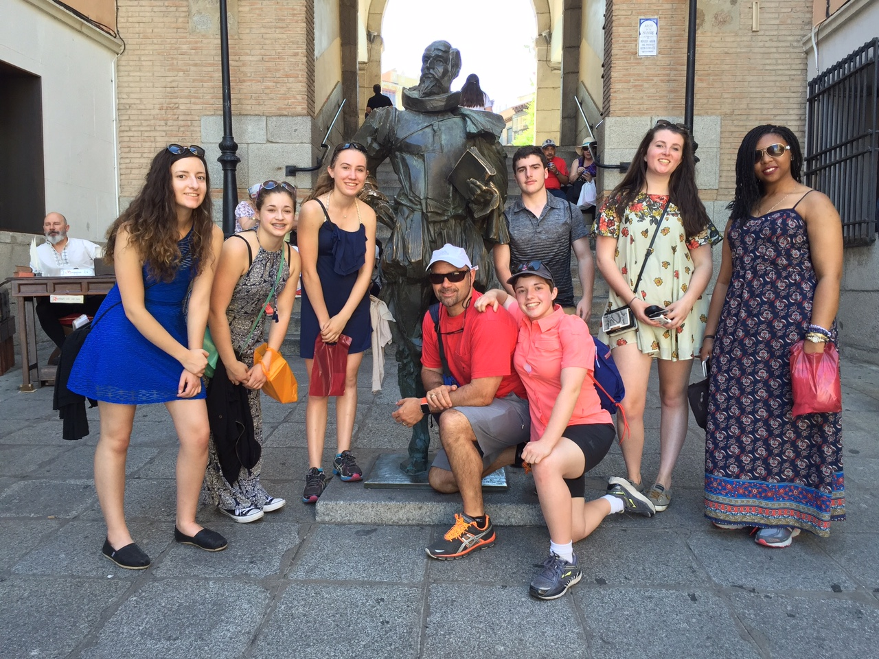 Students around a statue in Spain
